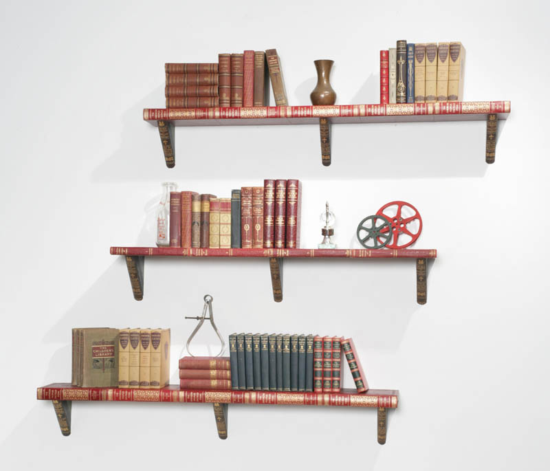 three large shelves from encyclopedias